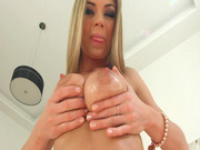 Lolly Gartner is coating her big natural boobies in oil