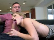 Teen Sydney Cole blows and deepthroat's huge cock on the sofa