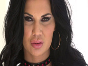 Buxom Brit Jasmine Jae flaunts her curves in fishnet stockings and little else