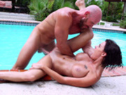 Big tits brunette Peta Jensen gets her pussy hammered by the pool