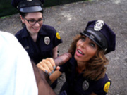 Officers Lyla Lali and Norah Gold suck a perps big black monster cock