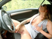 Milf Ava Austen masturbates while in her car