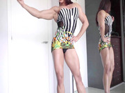 Karyn Bayres flexes her muscular body in front of a mirror