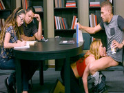 Carter Cruise drops to her knees to suck him off right in the library