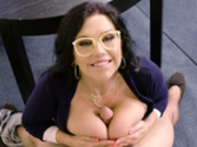 Huge breasted librarian Sheridan Love titty fucks a students hard cock