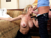 Multi tasking stepmom Brandi Love sucking cock and folding laundry