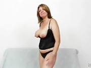 Busty cougar reveals her pussy