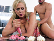 Blonde milf Julia Ann still manages to ice the cakes while getting fucked