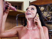 Ariella Ferrera takes a call right after a facial cumshot