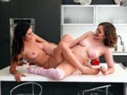 Mary Moody and Melissa Moore tribbing on the kitchen counter