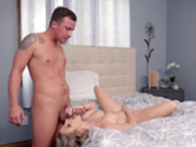 Cory Chase receives a facial cumshot while upside down on the bed