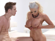 Nicolette Shea spits out cum all over her huge boobs