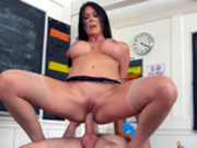 Busty milf teacher Reagan Foxx rides her very erect student on her desk