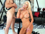 Busty Dominatrix Nicolette Shea enjoys some fresh cum from her sub