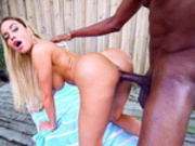 Victoria June enjoying that big black cock doggy style outdoors